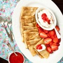 Dulce de Leche Crepes with Honey Whipped Cream and Strawberry Sauce