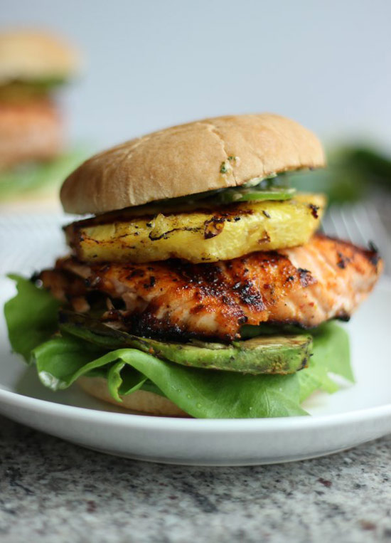 21. Tropical Salmon Burgers with Grilled Pineapple and Avocado