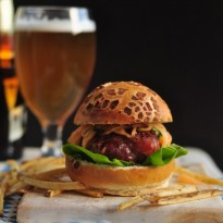 Prosciutto-Wrapped Burgers with Cantaloupe Slaw