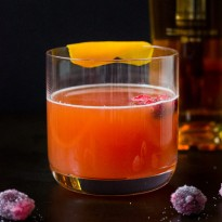 The Sangre and Sand Cocktail - a twist on the classic Blood & Sand cocktail with mezcal and cranberry syrup